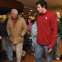 Photo - OU / COLLEGE FOOTBALL: University of Oklahoma quarterback Sam Bradford leaves a press conference after announcing he that will return for his junior season, Wednesday, Jan. 14, 2009, at the Stadium Club in Norman, Okla. PHOTO BY SARAH PHIPPS, THE OKLAHOMAN ORG XMIT: KOD