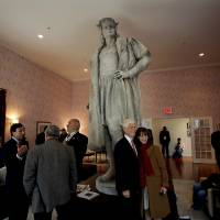 "Photo -   Leaders of the Italian-American community, civil servants from New York and Italy, including police and sanitation workers and other guests, stand in what is known as the living room created by artist Tatzu Nishi that surrounds Gaetano Russo's 1892 sculpture of Christopher Columbus 75 Feet Above Columbus Circle Sunday, Oct. 7, 2012, in New York. The art installation ""Tatzu Nishi: Discovering Columbus,"