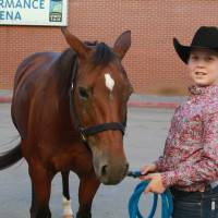 Photo - Hunter Bryant, 13, of Florida, one of the contestants at the American Quarter Horse Association's World Championship Show in Oklahoma City, poses with his horse. Photo provided