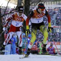 Photo - Germany's gold medal winner Eric Frenzel, right, and Japan's silver medal winner Akito Watabe ski during the cross-country portion of the Nordic combined at the 2014 Winter Olympics, Wednesday, Feb. 12, 2014, in Krasnaya Polyana, Russia. (AP Photo/Gregorio Borgia)