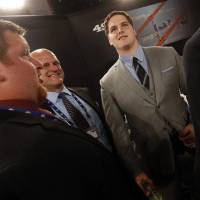 Photo - Luke Joeckel, right, from Texas A&M, stands in the green room before the first round of the NFL football draft, Thursday, April 25, 2013 at Radio City Music Hall in New York.  (AP Photo/Jason DeCrow)