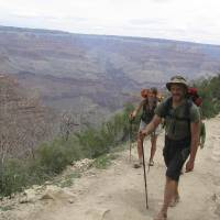 Photo - FILE-  In this file photo taken Tuesday, April 28, 2009, Eliza Anti, 31, and Michael Parker, 32, of Hardwick, Vt., near the end of their days-long hiking and camping trip at the Grand Canyon. The Grand Canyon is imposing new restrictions on hikers who are turning up in larger numbers to complete grueling