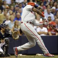Photo - Philadelphia Phillies' Domonic Brown hits a two-run single during the fifth inning of a baseball game against the Milwaukee Brewers Tuesday, July 8, 2014, in Milwaukee. (AP Photo/Morry Gash)