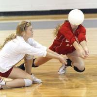 Photo - Cache players Megan Livsey (left) and Brooklyn Sullins return a ball to Oklahoma Christian in the Class 4A State Volleyball tournament at at Shawnee High School in Shawnee, OK, Friday, Oct. 7, 2011. By Paul Hellstern, The Oklahoman ORG XMIT: KOD