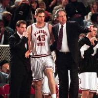 Photo - Eddie Sutton, right, gives instructions to John Nelson as assistant coach Sean Sutton listens in this 1994 photo.