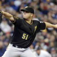 Photo - Pittsburgh Pirates starting pitcher Wandy Rodriguez throws during the first inning of a baseball game against the Milwaukee Brewers Thursday, May 15, 2014, in Milwaukee. (AP Photo/Morry Gash)