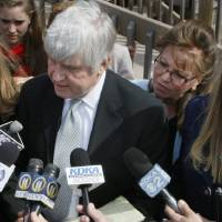 Photo - FILE - In this April 7, 2010 file photo, former Pennsylvania state Sen. Jane Orie, left, her sisters Janine Orie, right, and Pennsylvania Supreme Court Justice Joan Orie Melvin, center right, listen as their brother Jack Orie, center, reads a statement to the press outside a magistrate's office in Pittsburgh. With the conviction of Melvin and Janine Orie on Thursday, Feb. 21, 2013, and Jane Orie's 2012 conviction, all three sisters were found guilty in campaign related in campaign corruption crimes. (AP Photo/Keith Srakocic, File)