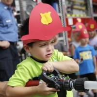 Children learn fire safety lessons during event