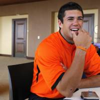 Photo - OSU quarterback Zac Robinson answers a question during the weekly Oklahoma State University college football press conference at Boone Pickens Stadium in Stillwater, Okla., Monday, September 24, 2007. BY MATT STRASEN, The Oklahoman ORG XMIT: KOD