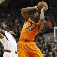 Photo -  It will be tough for Marcus Smart watching the next three games from the sidelines, says Berry Tramel. (AP Photo/Lubbock Avalanche-Journal, Tori Eichberger)