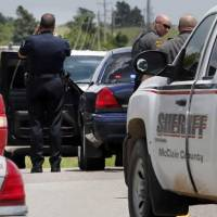 Photo - Police and OHP have blocked State Highway 9 both ways east of Pennsylvania as a woman with a gun was reported on the north service road near an antique store. on Thursday, July 18, 2013 in Newcastle, Okla. Photo by Steve Sisney, The Oklahoman