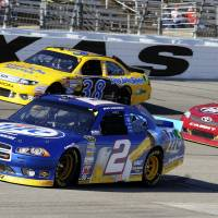 Photo -   Brad Keselowski (2) comes out of Turn 4 in front of David Gilliland (38) and Travis Kvapil, right, during the NASCAR Sprint Cup Series auto race, Sunday, Nov. 4, 2012, in Fort Worth, Texas. (AP Photo/Larry Papke)
