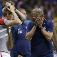 Photo - United States' head coach Juergen Klinsmann reacts during the World Cup round of 16 soccer match between Belgium and the USA at the Arena Fonte Nova in Salvador, Brazil, Tuesday, July 1, 2014. (AP Photo/Matt Dunham)