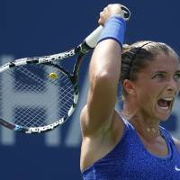 Photo - Sara Errani, of Italy, returns a shot against Mirjana Lucic-Baroni, of Croatia, during the fourth round of the 2014 U.S. Open tennis tournament, Sunday, Aug. 31, 2014, in New York. (AP Photo/Kathy Willens)