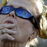Photo - St. Louis Rams fan Lois Linton, of Collinsville, Ill., watches the Rams' first official workout of training camp at the NFL football team's practice facility on Friday, July 25, 2014, in St. Louis. (AP Photo/Jeff Roberson)