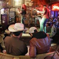 Photo - This Jan. 15, 2014 photo shows Tootsie's Orchid Lounge on Lower Broadway in Nashville, Tenn. Most of the bars on lower Broadway are free from cover charges, although it's always good to tip the band when they pass the bucket around. (AP Photo/Mark Humphrey)