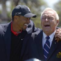 Photo - FILE - In this March 25, 2013 file photo, Tiger Woods, left, and Arnold Palmer share a laugh during the trophy presentation after Woods won the Arnold Palmer Invitational golf tournament in Orlando, Fla. Fifty years ago, Arnold Palmer won the Masters for the fourth time. It was his seventh major. He was 34, the King. (AP Photo/Phelan M. Ebenhack, File)