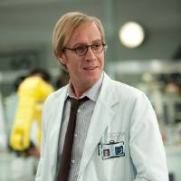 Photo - Rhys Ifans plays Dr. Curt Conners, aka