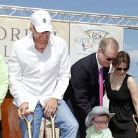 Photo - Toby Keith, left, watches as Brock Hart, 3, from Edmond, shovels dirt during groundbreaking ceremonies for the OK Kids Korral, to be built by the Toby Keith Foundation at NE 8 and Laird, in Oklahoma City Friday, May 18, 2012. Keith said in a recent interview that Brock is now cancer-free, and the OK KIds Korral will open this fall. Photo by Paul B. Southerland, The Oklahoman Archives  PAUL B. SOUTHERLAND - PAUL B. SOUTHERLAND