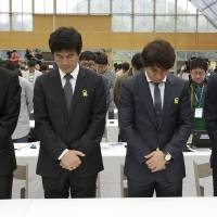 Photo - South Korea's national soccer team coach Hong Myung-bo, right, and other coaches pay silent tribute to the victims of the sunken ferry Sewol before announcement of the national team lineup for the upcoming Brazil World Cup at National Football Center in Paju, South Korea, Thursday, May 8, 2014. (AP Photo/Lee Jin-man)