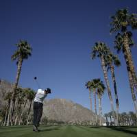 Photo - Zach Johnson hits from the 13th tee during a practice round for the Humana Challenge golf tournament on the Palmer Private course at PGA West, Wednesday, Jan. 15, 2014, in La Quinta, Calif. (AP Photo/Chris Carlson)