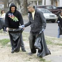 Photo - Victor Morales, left, and Jesse Becerra pick up trash during the UCO Big Event Day near SW 5 and Dewey in Oklahoma City.  By Paul Hellstern, The Oklahoman  PAUL HELLSTERN - Oklahoman