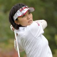 Photo - Taiwan's Teresa Lu watches her tee shot on the second hole during the final round of the Mizuno Classic golf tournament in Shima, Mie prefecture, western Japan Sunday, Nov. 10, 2013. Lu won the Mizuno Classic on Sunday. (AP Photo/Kyodo News) JAPAN OUT, MANDATORY CREDIT