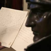 Photo - In this photo taken Wednesday, Nov. 28, 2012, a letter dictated and signed by Napoleon in secret code that declares his intentions