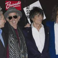 Photo -  This Thursday, July 12, 2012 file photo shows, from left, Charlie Watts, Keith Richards, Ronnie Wood and Mick Jagger, from the British Rock band, The Rolling Stones, as they arrive at a central London venue, to mark the 50th anniversary of the Rolling Stones first performance. The legendary band said Monday it would return to the stage this year with four concerts in New York and London. The shows mark the first time in five years at the Stones have performed live, with Mick Jagger, Keith Richards, Charlie Watts and Ronnie Wood all coming together once more. (AP Photo/Jonathan Short)