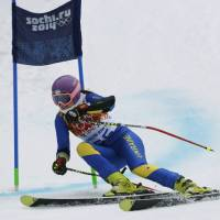 Photo - In this Saturday, Feb. 15, 2014 photo, Ukraine's Bogdana Matsotska passes a gate in the women's super-G at the Sochi 2014 Winter Olympics in Krasnaya Polyana, Russia. The International Olympic Committee said on Thursday, Feb. 20, that Matsotska has left the Olympics in response to the violence in her country. (AP Photo/Charles Krupa)