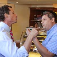 Photo - Anthony Weiner, left, who is seeking the Democratic nomination to run for the New York City Mayor's Office, has a heated argument with Shaul Kessler at Weiss Bakery in the Boro Park neighborhood in the Brooklyn borough of New York, Wednesday, Sept. 4, 2013. The altercation was captured on video and is circulating widely over the Internet. Weiner's support as a Democratic candidate for mayor collapsed amid a new sexting scandal in June, 2013 and is currently polling fourth among the candidates at 7 percent. (AP Photo/Shimon Gifter)