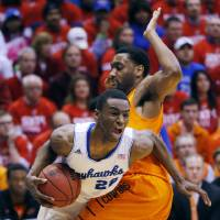 Photo - Kansas guard Andrew Wiggins (22) is fouled by Oklahoma State guard Brian Williams during the first half of an NCAA college basketball game at Allen Fieldhouse in Lawrence, Kan., Saturday, Jan. 18, 2014. (AP Photo/Orlin Wagner)