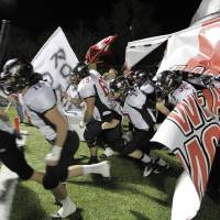 Photo - The Westmoore Jaguars take the field before a 2011 game against Midwest City.  Photo from The Oklahoman Archives