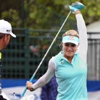 Photo - Lexi Thompson stretches on the first tee during a pro-am for the Shoprite Classic golf tournament in Galloway, N.J., , Thursday, May 29, 2013. (AP Photo/The Press of Atlantic City, Michael Ein) MANDATORY CREDIT
