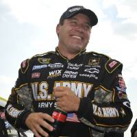 Photo -   NASCAR driver Ryan Newman is all smiles after his qualifying attempt at the Talladega Superspeedway in Talladega, Ala., Saturday, Oct. 6, 2012. The drivers were qualifying for the Sunday running of the NASCAR Sprint Cup Series auto race. (AP Photo/Rainier Ehrhardt)