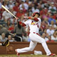 Photo - St. Louis Cardinals' Oscar Taveras (18) follows through on his RBI single against the Boston Red Sox in the first inning in a baseball game, Thursday, August 7, 2014, at Busch Stadium in St. Louis. (AP Photo/Bill Boyce)