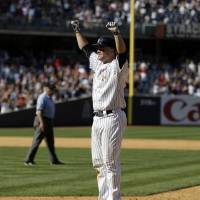 Photo - New York Yankees' Brian McCann reacts after his fly ball is dropped, allowing the winning run to score, during the ninth inning of a baseball game against the Cincinnati Reds at Yankee Stadium, Sunday, July 20, 2014, in New York. The Yankees defeated the Reds 3-2. (AP Photo/Seth Wenig)
