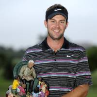 Photo - Scotland's Scott Jamieson holds the trophy after winning the inaugural Nelson Mandela Championship Golf tournament in Durban, South Africa, Sunday, Dec. 9, 2012. (AP Photo)