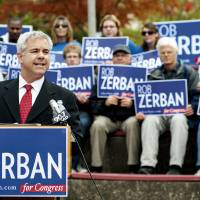 Photo -   This photo taken Oct. 3, 2012 shows Wisconsin Congressional candidate Rob Zerban speaking at campaign event inJanesvilles, Wis. As Zerban spent his morning on his hands and knees scrubbing a toilet in a homeless shelter. Half a country away, Paul Ryan stood under a spotlight in Virginia talking about why he should be the next vice president. So it goes in Zerban's longshot bid to seize the House seat Ryan has held for 14 years. While the Republican vice presidential hopeful has jetted around the country touting Mitt Romney, the Kenosha Democrat has been getting his hands dirty in southern Wisconsin's 1st Congressional District. (AP Photo/Mark Kauzlarich, The Janesville Gazette)