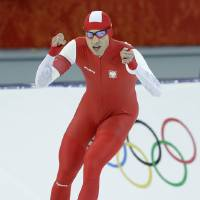 Photo - Gold medallist Poland's Zbigniew Brodka  celebrates after racing in the men's 1,500-meter speedskating at the Adler Arena Skating Center during the 2014 Winter Olympics in Sochi, Russia, Saturday, Feb. 15, 2014. (AP Photo/Patrick Semansky)