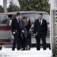 Photo - Family members of confessed serial killer Israel Keyes enter a funeral home, Sunday, Dec. 9, 2012, in Deer Park, Wash. Keyes confessed to killing eight people across the country before he committed suicide recently in a jail cell in Anchorage, Alaska. (AP Photo/Young Kwak)