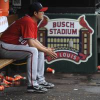 Photo -   Washington Nationals pitcher Chien-Ming Wang, of Taiwan, sits in the dugout after being pulled out of a baseball game during the fifth inning against the St. Louis Cardinals Sunday, Sept. 30, 2012, in St. Louis. (AP Photo/Bill Boyce)