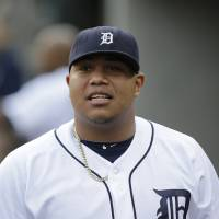 Photo - FILE - In this Aug. 26. 2013, file photo, Detroit Tigers pitcher Bruce Rondon watches from the dugout during the second inning of a baseball game against the Oakland Athletics in Detroit. Rondon needs surgery to repair a torn ligament in his right elbow and will be sidelined for the entire season, general manager Dave Dombrowski said Friday, March 21, 2014. (AP Photo/Paul Sancya, File)