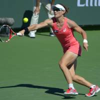 Photo - Samantha Stosur, of Australia, returns a shot against Peng Shuai, of China, during their match at the BNP Paribas Open tennis tournament, Monday, March 11, 2013, in Indian Wells, Calif. (AP Photo/Mark J. Terrill)