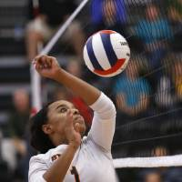 Photo - Booker T. Washington's Meriden Lee returns a ball against Shawnee during the Class 5A State Championship volleyball tournament on Friday, Oct. 12, 2012, in Moore, Okla.  Photo by Steve Sisney, The Oklahoman