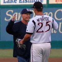Photo - Jeremy McBryde hugs his dad, Travis McBryde, before Travis throws out the first pitch at Jeremy's baseball game in 2011. Travis McBryde died in 2011  from colon cancer .  Photo Provided   Provided