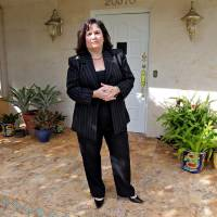 Photo -   In this Oct. 23, 2012, photo, Hilda Mitrani, 51, of North Miami Beach, Fla., poses by her home in Miami. Mitrani has a marketing consulting company and is among many feeling squeezed by a painfully sluggish economic rebound. Unemployment remains high at 7.8 percent. Average pay trails inflation. And the economy is growing too slowly to accelerate hiring. Polls consistently find that the economy is the top concern of voters, and Romney tends to get an edge over Obama when people are asked who might do better with it. Whether that truly drives how Americans vote is a crucial question for Election Day. (AP Photo/Robert Ray)