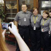 Photo - Neil Gagel, Audrey Mann, Melissa Lower, and Jaclyn Burnett, pose for a photo as the Oklahoma City Police Department's first class of Civilian Investigation Specialists and civilian crime scene investigators graduate at the Oklahoma City Police Department on Friday.  Photo by Paul Hellstern, The Oklahoman  PAUL HELLSTERN