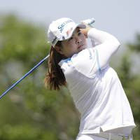 Photo - Inbee Park, of South Korea, watches her tee shot on the second hole during the final round of the North Texas LPGA Shootout golf tournament on Sunday, April 28, 2013, at Los Colinas Country Club in Irving, Texas. (AP Photo/LM Otero)