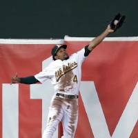 Photo -   Oakland Athletics left fielder Coco Crisp makes a leaping catch on a ball hit by Detroit Tigers' Prince Fielder during the second inning of Game 3 of an American League division baseball series in Oakland, Calif., Tuesday, Oct. 9, 2012. (AP Photo/Ben Margot)